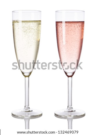 Glasses of white and rose champagne isolated - stock photo