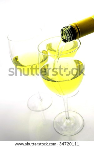 Glasses of white wine isolated against a white background