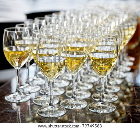 Glasses of white wine on bar counter, selective focus - stock photo