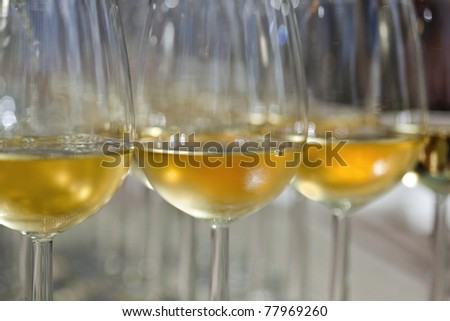Glasses of white wine to taste, on a table of a wine shop