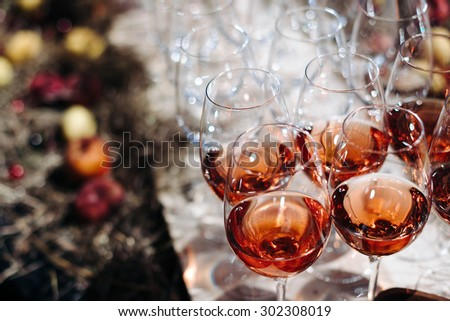 glasses of wine alcohol red glass on a buffet table at a banquet apperetive - stock photo