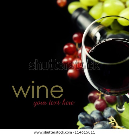 Glasses of  wine and grape on black background  (easy removable sample text) - stock photo