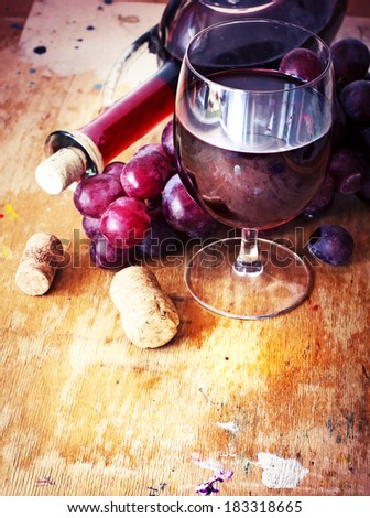 Glasses of wine and grape  on texture rusty wooden background - stock photo