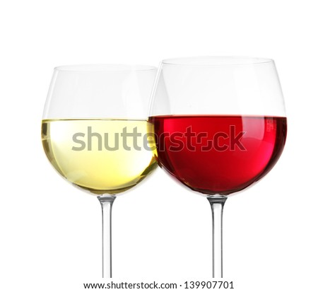 Glasses of wine close-up on light background