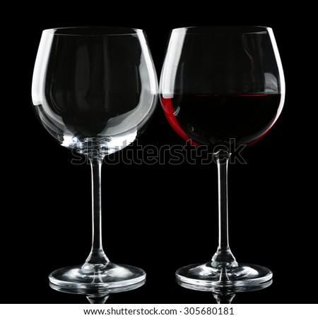 Glasses of wine isolated on black - stock photo