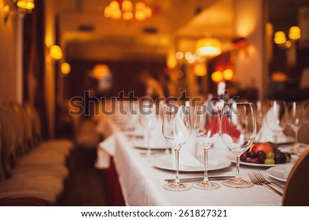 glasses of wine on a table in a restaurant - stock photo