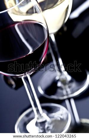 Glasses of  wine on black background - stock photo