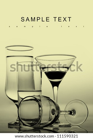 Glasses of  wine on white and black. Space for text isolated on white. Black background. - stock photo