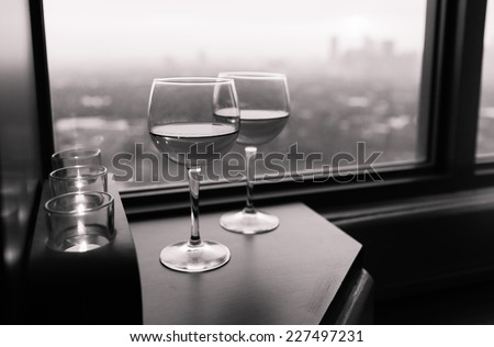 Glasses of wine with city view - stock photo