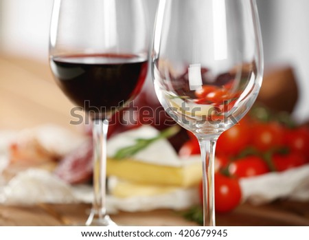 Glasses Of Wine With Food On Table Closeup