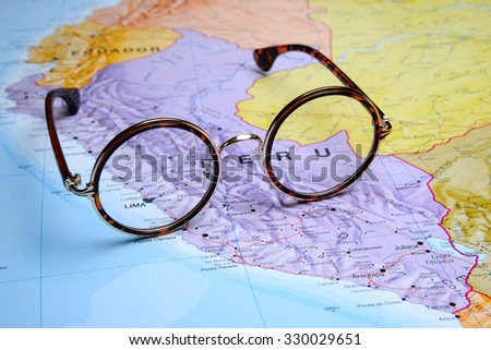 Glasses on a map - Lima