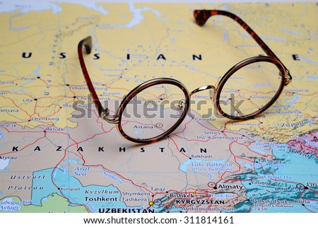 Glasses on a map of Asia - Astana