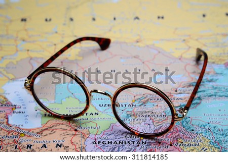 Glasses on a map of Asia - Tajikistan