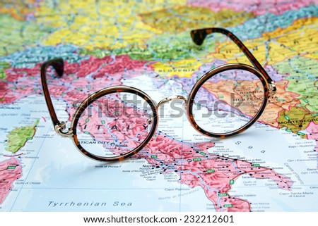 Glasses on a map of europe - Italy  - stock photo