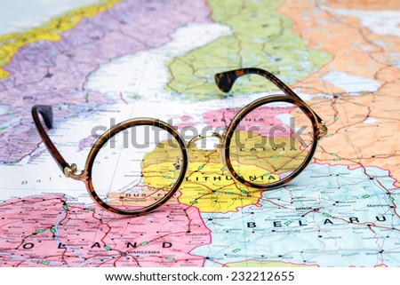 Glasses on a map of europe - Latvia