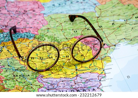 Glasses on a map of europe - Romania