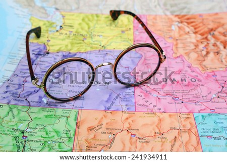 Glasses on a map of USA - Oregon