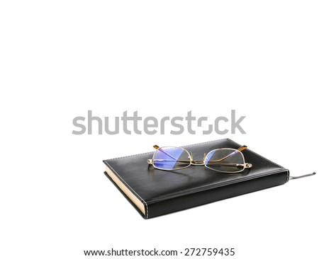 glasses on a notepad  - stock photo