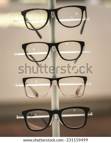Glasses on display in retail store - stock photo