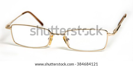 Glasses on eye close-up isolated on white background - stock photo
