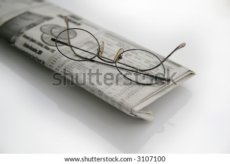 glasses on financial newspaper - stock photo