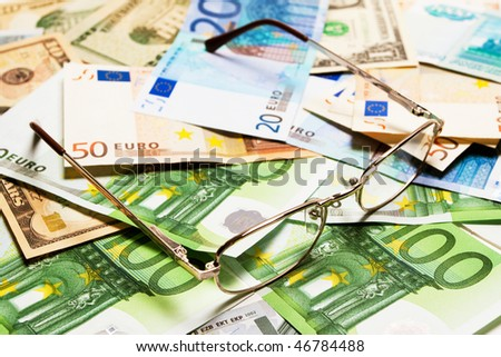 glasses on money (dollar and euro)  background for any design work