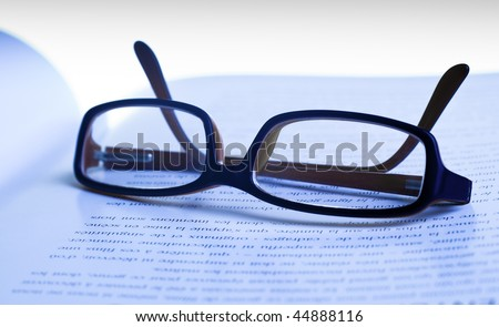 Glasses on paper macro