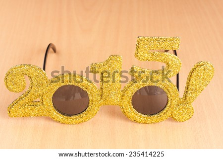 Glasses on plywood background