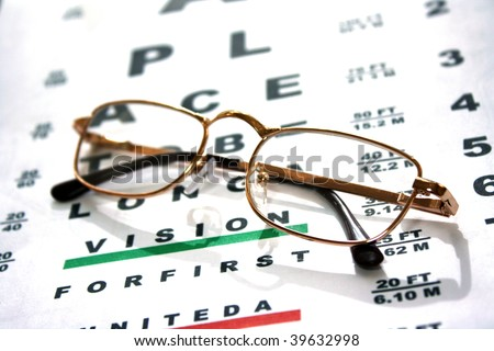 Glasses on test chart - stock photo