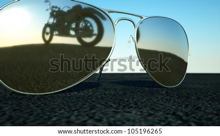 glasses on the asphalt �  reflect the bike