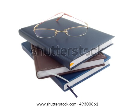 Glasses on the books. Isolated on white.
