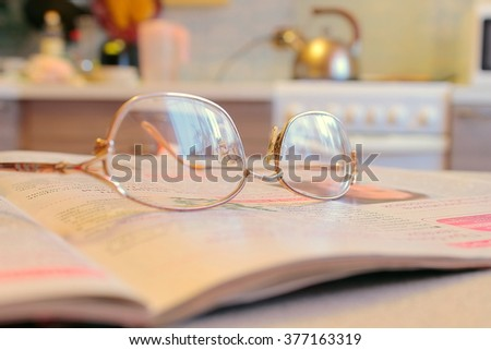 glasses on the newspaper - stock photo