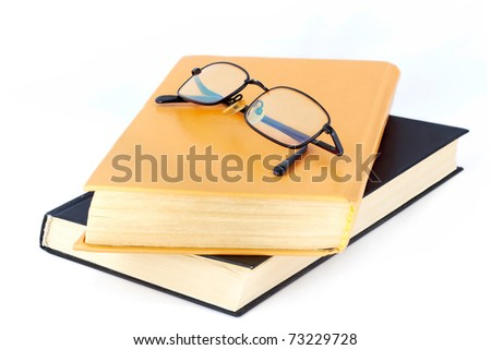 Glasses on the old books - stock photo