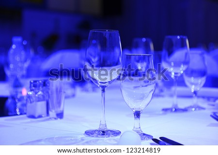 Glasses on the table for a dinner party - stock photo