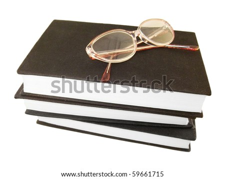 Glasses over some books - stock photo