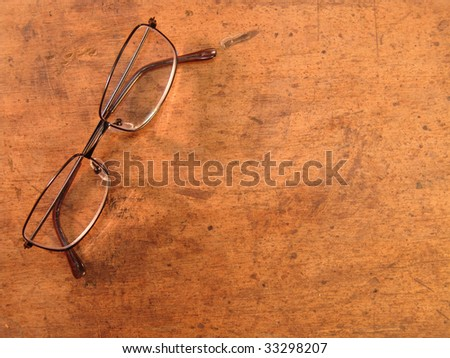 glasses over wood background