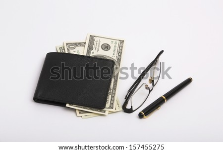 Glasses, Pen and a Leather purse with money (Isolated). - stock photo