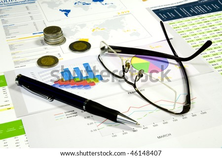 Glasses, pen and money in finance analyzing