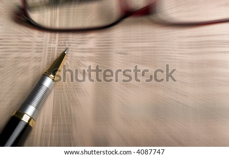 Glasses, pen over mutual funds data on newspaper. Blur effect used. - stock photo