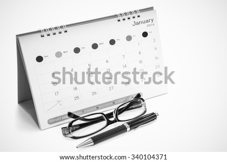Glasses, pens, calendars isolated on white - stock photo