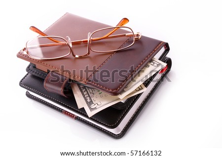 Glasses, purse and dollar banknotes
