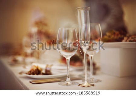 Glasses set with drinks and dishes in restaurant - stock photo