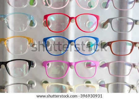 Glasses shop hang show colorful for customer select. - stock photo