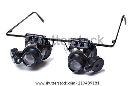 glasses type watch magnfier with led light it is isolated on a white background - stock photo