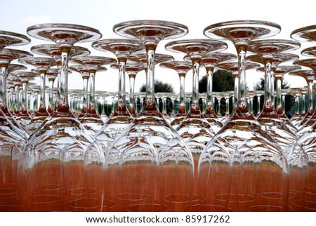 glasses upside down on a red tablecloth