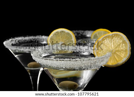 glasses with a martini on a black background - stock photo