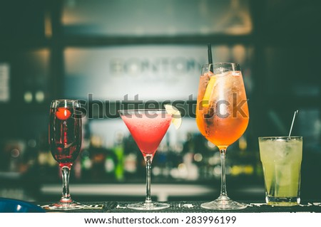 Glasses with alcohol drink on the bar - stock photo