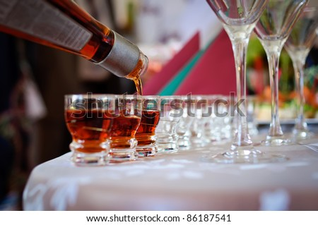 Glasses with alcohol in bar - stock photo