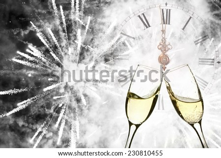 Glasses with champagne against holiday lights and fireworks - stock photo