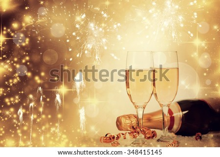 Glasses with champagne and bottle over magical bokeh holiday background